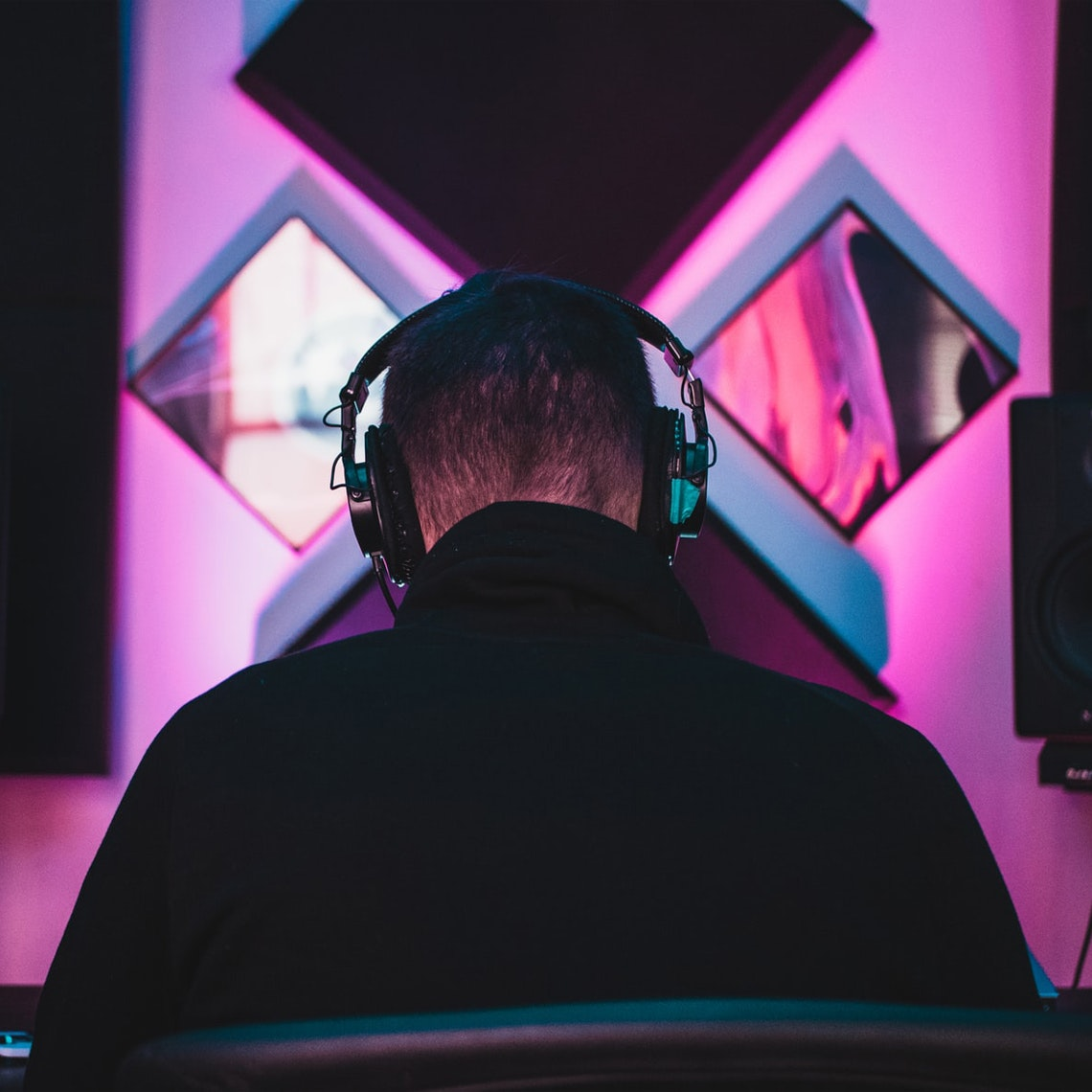A producer in a studio working on music