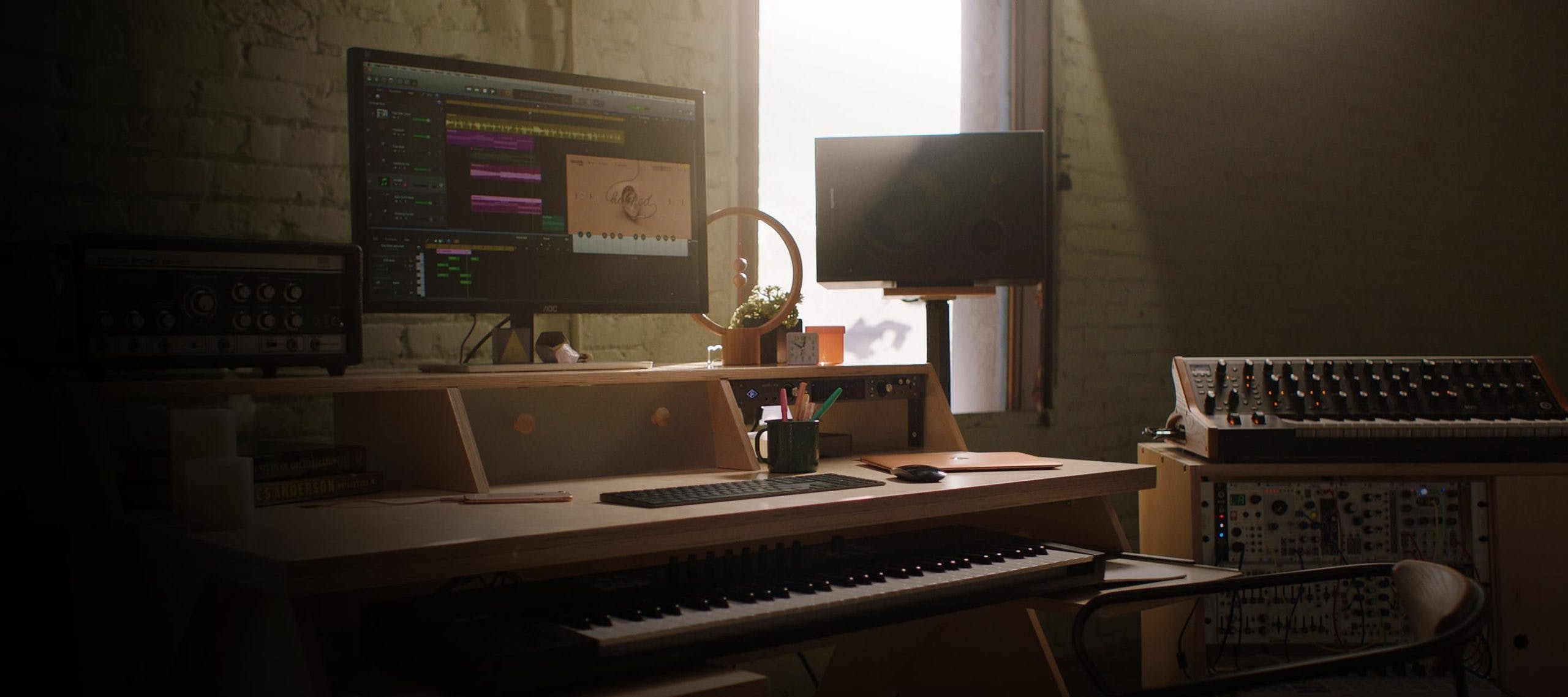 Studio setup with natural color Output Platform desk and natural color Output Sidecar accessory.