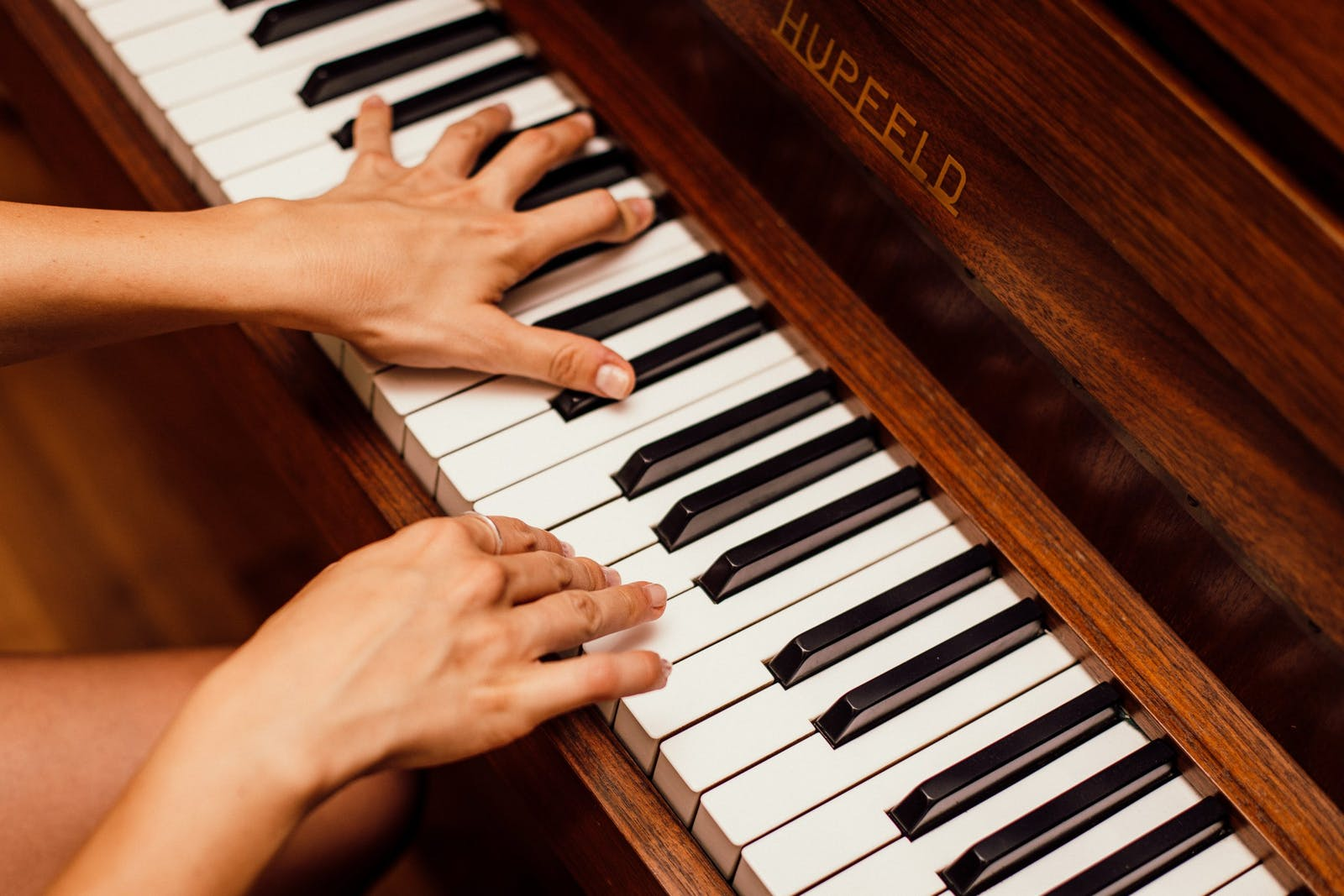 Musician practicing on a Hupfeld piano